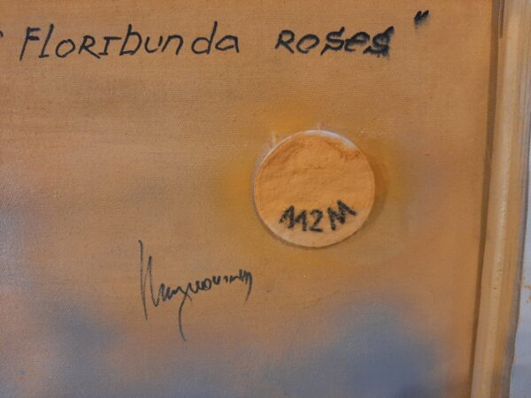 "The back of a cotton painting """"The evening scent of floribunda roses"" by W2W. Close-up"